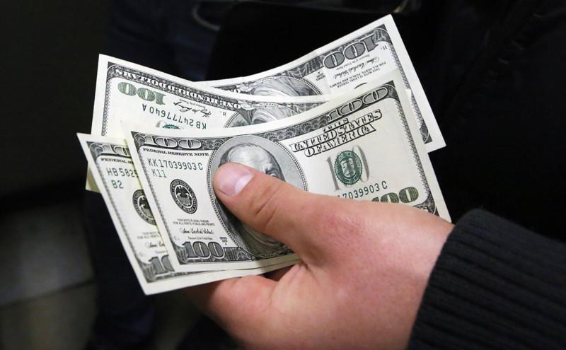 Курс доллара вырос до 71,55 рублей